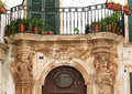 Sculptures and balcony in martina franca italy typical italian above a door under a the italian town of a comune the province of Royalty Free Stock Photography