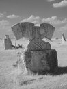 Sculptures where three countries meet monochrome infrared picture of a sculpture of stone reminding of the year when at this place Royalty Free Stock Photos