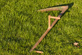 Scythe in grass Stock Photos