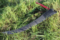 Scythe on grass Royalty Free Stock Image