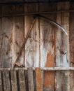 Scythe hanging on the shed wall Stock Images