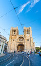 Se lisbon cathedral with a traditional yellow tram in lisbon portugal Royalty Free Stock Photography