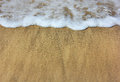 Sea ​​waves and wet sand on the beach as summer background Stock Images