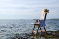 By the sea armchair close to water at island oland in sweden Stock Photos