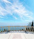 Sea and balcony under cloudy sky Royalty Free Stock Photo