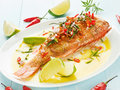 Sea bass steamed with chili pepper rosemary bacon and shallot onion in olive and linseed oil shallow dof Stock Images
