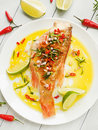 Sea bass steamed with chili pepper rosemary bacon and shallot onion in olive and linseed oil shallow dof Stock Image