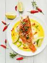 Sea bass steamed with chili pepper rosemary bacon and shallot onion in olive and linseed oil viewed from above Royalty Free Stock Images