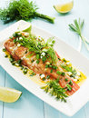 Sea bass steamed with fennel and leek in olive and linseed oil viewed from above Stock Image