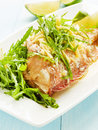 Sea bass steamed with rucola and ginger in olive and linseed oil shallow dof Royalty Free Stock Photos