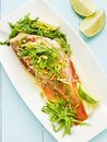 Sea bass steamed with rucola and ginger in olive and linseed oil shallow dof Royalty Free Stock Image
