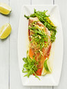 Sea bass steamed with rucola and ginger in olive and linseed oil viewed from above Royalty Free Stock Images