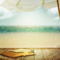 Sea beach old book against background Royalty Free Stock Photography