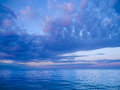 Sea with beautiful sky calm moody and cloudy evening Royalty Free Stock Image