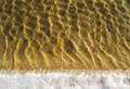 Sea bottom texture, yellow sand waves in shallow water. Royalty Free Stock Photo