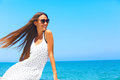 Sea breeze girl with long hair smiling and relaxing Stock Photos