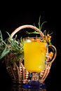 Sea buckthorn tea in a cup on a black background Stock Image
