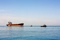 Sea bulk carrier with pilot boats transport vessel on external raid before calling in seaport Stock Photography