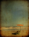 Sea chairs with umbrella grunge effect in sunny day Royalty Free Stock Images
