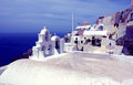 Sea and church on santorini island in greece Stock Photos