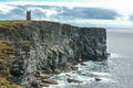 Sea cliffs with medieval tower in Orkeny Scotland Royalty Free Stock Photo