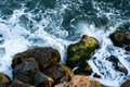 Sea coast with rocks blue wit shot from above Royalty Free Stock Photo