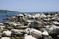 Sea coast row of stone wave breaker Royalty Free Stock Photography