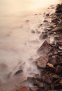 Sea coast wave and rock at sunset Stock Image