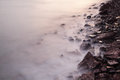 Sea coast wave and rock during sunset Stock Images