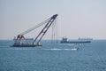 The sea crane on a tow