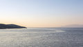 Sea current wake of gentle ocean shown in quiet water gulf of corinth greece pink dawn light Stock Images