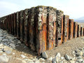 Sea defences wales rusty taken at low tide on llandanwg beach barmouth Royalty Free Stock Images