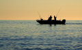 Sea fishermen silhouette on boat over the Stock Photo