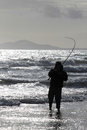 Sea fishing from beach at Harlech, Wales Royalty Free Stock Photo