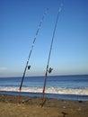 Sea fishing rods on beach Royalty Free Stock Photo