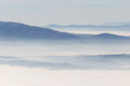 Sea of fog with hills and mountains Royalty Free Stock Photo
