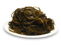 Sea food seaweed on the white plate isolated object Stock Images