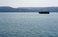 Sea of galilee boat with tourists floating on the near capernaum Stock Photos