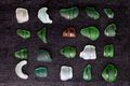 Sea glass bottlenecks collection of old on blackboard background Royalty Free Stock Images