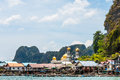 A sea gypsy village at phang nga bay thailand floating with beautiful mosque behind their houses Royalty Free Stock Image