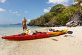 Sea kayak at the beach lonely sandy Royalty Free Stock Image