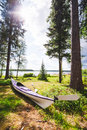 Sea kayak lying in the grass a purple touring is close to ocean a beautiful scandinavian forest setting location Stock Photography