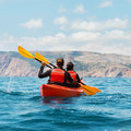 Sea kayak young couple in a on a voyage Royalty Free Stock Photo