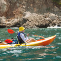 Sea kayak a young female in a yellow kayaking Royalty Free Stock Images