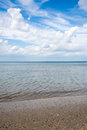 Sea landscape beach and sky whit clouds on summer day Stock Image