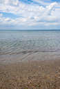 Sea landscape beach and sky whit clouds on summer day Stock Images