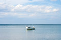 Sea landscape with boat and sky whit clouds on summer day Royalty Free Stock Image