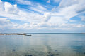 Sea landscape with boat and sky whit clouds on summer day Royalty Free Stock Photos