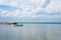 Sea landscape with boat and sky whit clouds on summer day Stock Photography