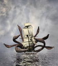 Sea monster the tentacles of a giant octopus are attacking a ship Royalty Free Stock Image